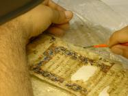 Removal procedure of an older wrong intervention on a parchment manuscript.