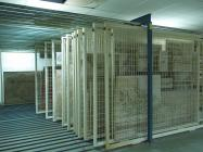 General view of the storeroom of mural paintings with rolling suspension system. Mural paintings in portable supports.